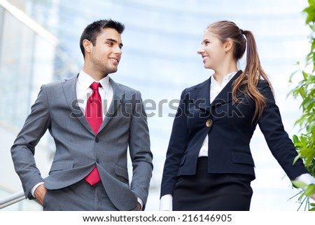 Couple of  young business people talking outdoor - stock photo