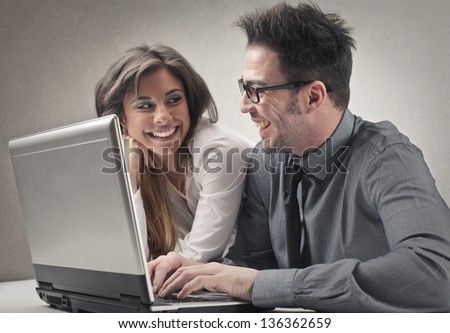 couple of young colleagues at work - stock photo