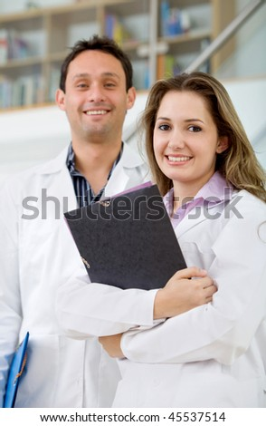 Couple of young doctors smiling at the hospital
