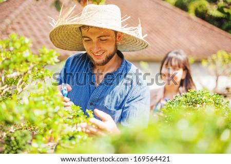 Couple of young gardeners  - stock photo