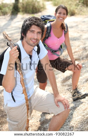 Couple of young hikers - stock photo