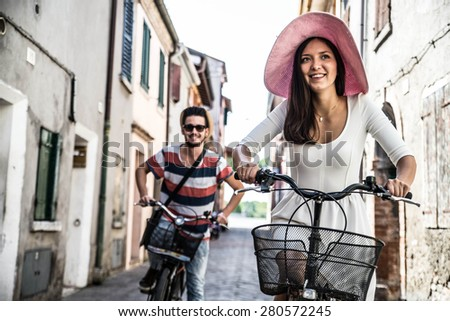 couple of young people are riding on the bike in the city center - lifestyle concept - stock photo