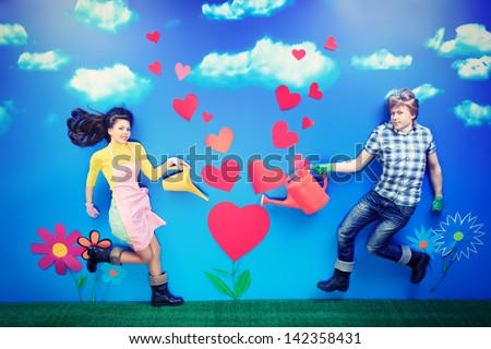 Couple of young people growing their love like a tender flower. - stock photo
