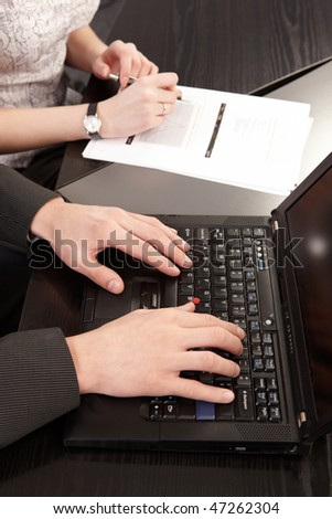 couple of young people in the office working together hands  only - stock photo
