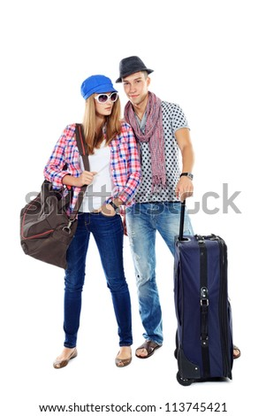 Couple of young people standing together with suitcases over white background. - stock photo
