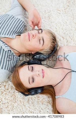Couple of young Teenagers listening to music - stock photo