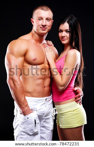 Couple of young woman and man with good bodies - stock photo