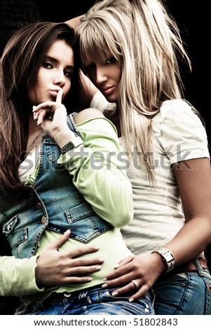 couple of  young women in blue jeans outdoor shot