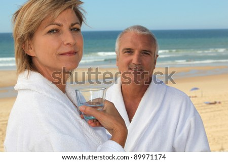 Couple on a beach in bathrobes