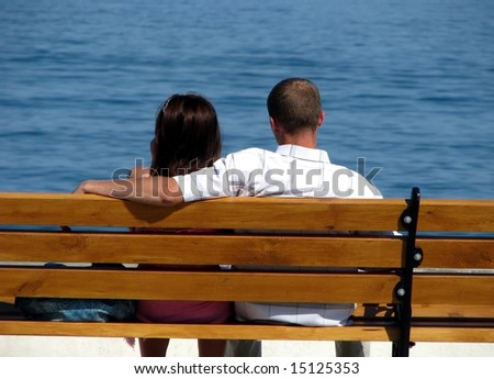 Couple on a bench - stock photo