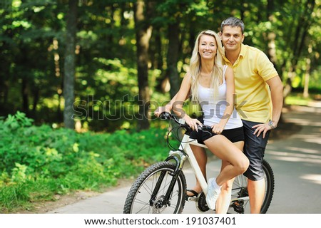 Couple on a bike in a countryside - stock photo