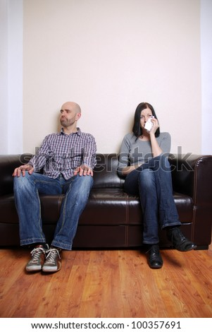 couple on a couch has an argument