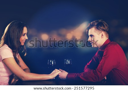 Couple on a date drinking wine. - stock photo
