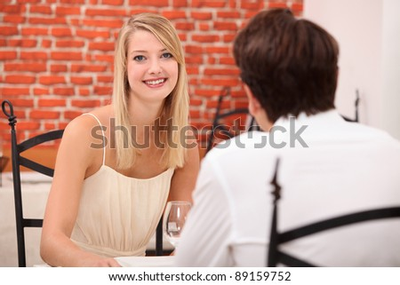 Couple on a date in a restaurant - stock photo