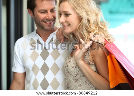 Couple on a happy shopping trip - stock photo