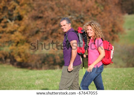 Couple on a hiking day - stock photo