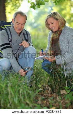 Couple on a nature trek - stock photo