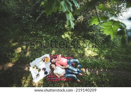 Couple on a picnic - stock photo
