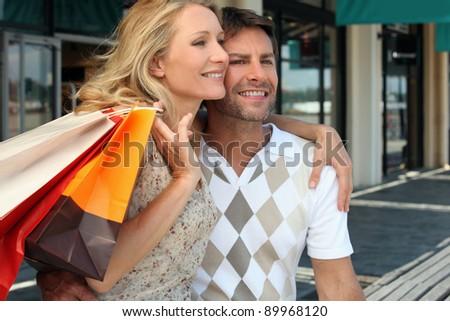 Couple on a shopping spree - stock photo