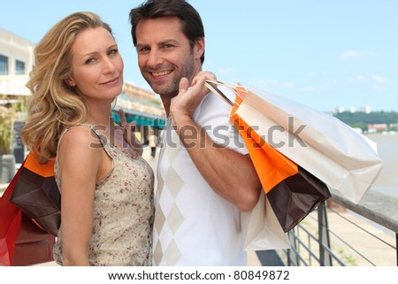 Couple on a shopping trip - stock photo