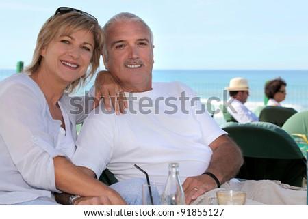 Couple on a terrace - stock photo