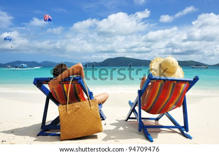 Couple on a tropical beach - stock photo