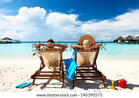 Couple on a tropical beach at Maldives - stock photo