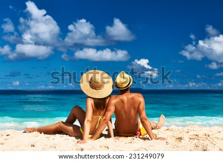 Couple on a tropical beach at Seychelles - stock photo