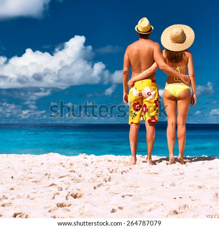 Couple on a tropical beach at Seychelles, La Digue - stock photo
