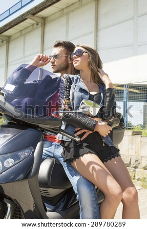 Couple on a vespa on a summer day - stock photo