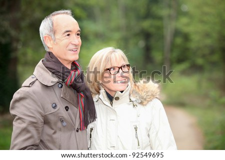 Couple on an autumn stroll - stock photo