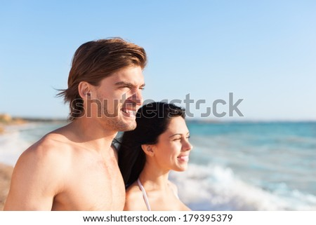 Couple on beach, Close up faces looking side ocean horizon copy space, Young happy man and woman sea shore smiling romantic, summer vacation holiday - stock photo