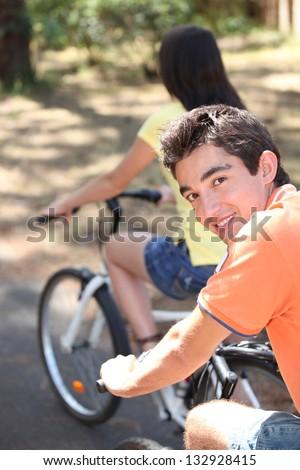 Couple on bicycle - stock photo