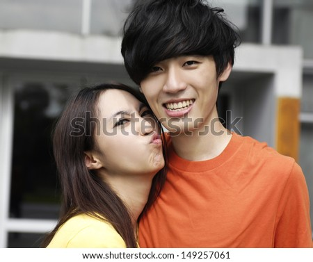 couple on campus embracing each other - stock photo