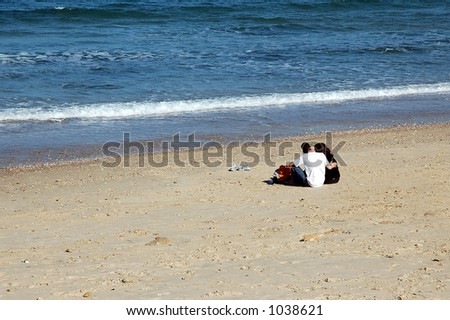 Couple on empty beach