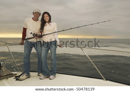 Couple on fishing boat, (portrait)