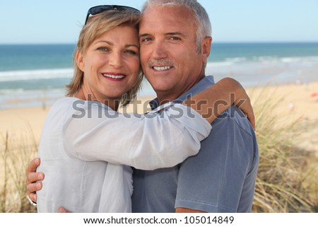 Couple on holiday by the seaside - stock photo