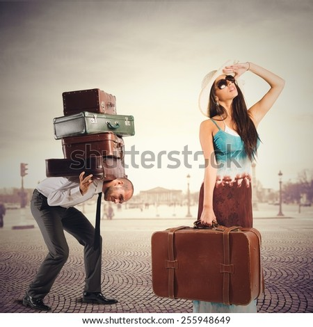 Couple on holiday she relaxes him labors - stock photo