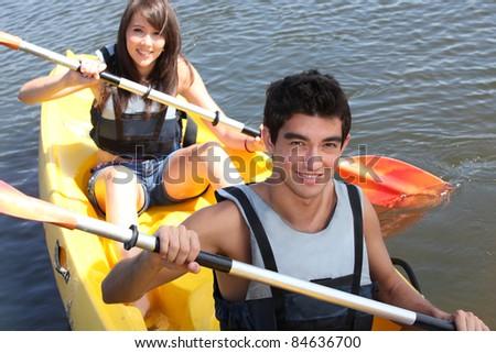 couple on kayak - stock photo