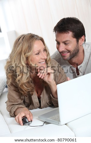 Couple on laptop looking into each other's eyes