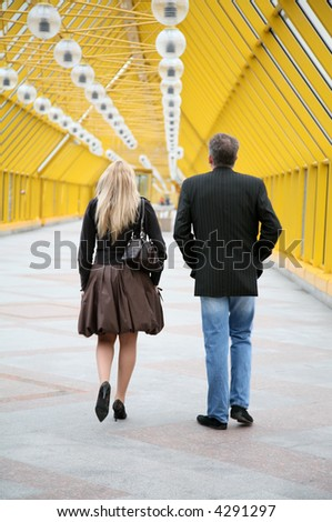 couple on pedestrian bridge - stock photo