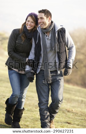 Couple on romantic country walk in winter - stock photo