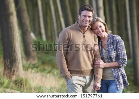 Couple On Romantic Country Walk Through Woodland - stock photo