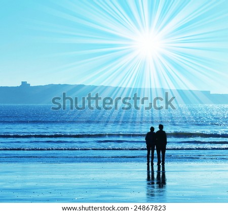 Couple on sea coast - stock photo