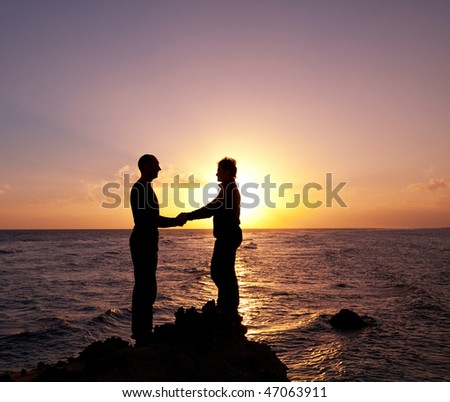 Couple on sunset - stock photo
