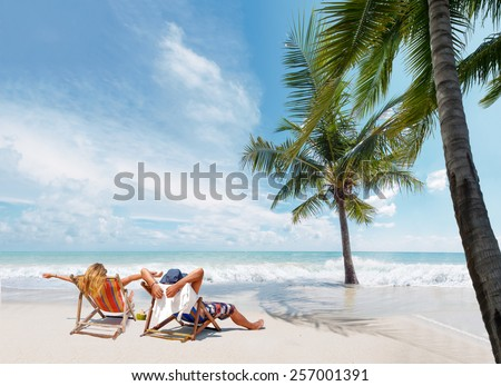 Couple on the beach at tropical resort Travel concept - stock photo