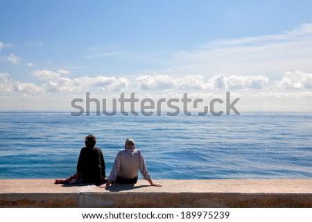 Couple on the beach. Seascape. - stock photo