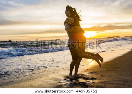 Couple  on the beach with a beautiful sunset