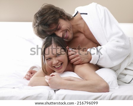Couple on the bed.