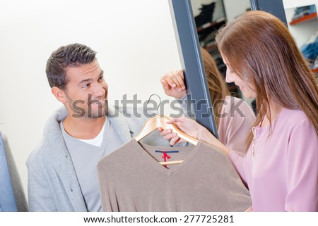 Couple on the hunt for new clothes - stock photo